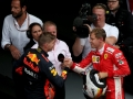 SPA, BELGIUM - AUGUST 26: Race winner Sebastian Vettel of Germany and Ferrari shakes hands with third place finisher Max Verstappen of Netherlands and Red Bull Racing in parc ferme during the Formula One Grand Prix of Belgium at Circuit de Spa-Francorchamps on August 26, 2018 in Spa, Belgium.  (Photo by Charles Coates/Getty Images)