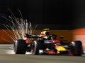 SINGAPORE - SEPTEMBER 14:  Sparks fly behind Max Verstappen of the Netherlands driving the (33) Aston Martin Red Bull Racing RB14 TAG Heuer on track during practice for the Formula One Grand Prix of Singapore at Marina Bay Street Circuit on September 14, 2018 in Singapore.  (Photo by Clive Mason/Getty Images)