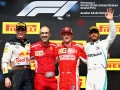 AUSTIN, TX - OCTOBER 21:  Race winner Kimi Raikkonen of Finland and Ferrari, second placed Max Verstappen of Netherlands and Red Bull Racing and third placed Lewis Hamilton of Great Britain and Mercedes GP celebrate on the podium during the United States Formula One Grand Prix at Circuit of The Americas on October 21, 2018 in Austin, United States.  (Photo by Mark Thompson/Getty Images)