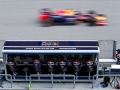 KUALA LUMPUR, MALAYSIA - MARCH 29:  Daniel Ricciardo of Australia and Infiniti Red Bull Racing passes members of his team on the pit perch during the Malaysia Formula One Grand Prix at Sepang Circuit on March 29, 2015 in Kuala Lumpur, Malaysia.  (Photo by Mark Thompson/Getty Images)
