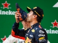 SHANGHAI, CHINA - APRIL 15:  Race winner Daniel Ricciardo of Australia and Red Bull Racing celebrates on the podium with a shoey during the Formula One Grand Prix of China at Shanghai International Circuit on April 15, 2018 in Shanghai, China.  (Photo by Lars Baron/Getty Images)