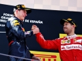 MONTMELO, SPAIN - MAY 15: Max Verstappen of Netherlands and Red Bull Racing is congratulated on his first F1 win on the podium by Sebastian Vettel of Germany and Ferrari during the Spanish Formula One Grand Prix at Circuit de Catalunya on May 15, 2016 in Montmelo, Spain.  (Photo by Clive Mason/Getty Images)
