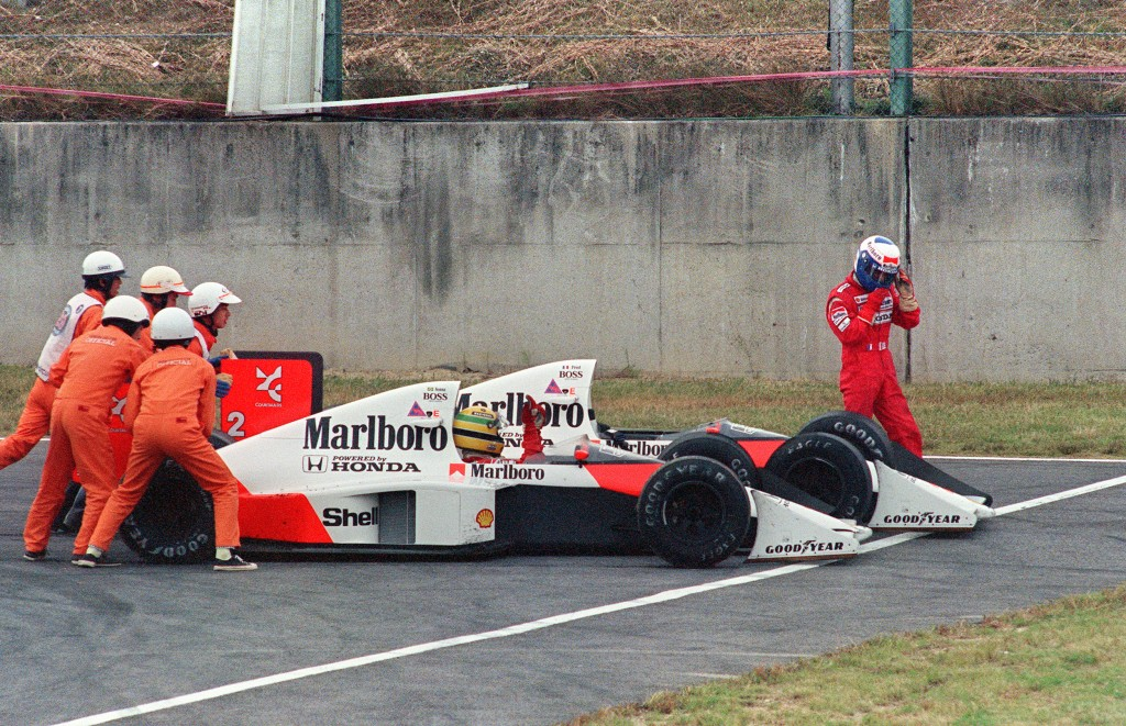 Ayrton Senna of Brazil is given a push f