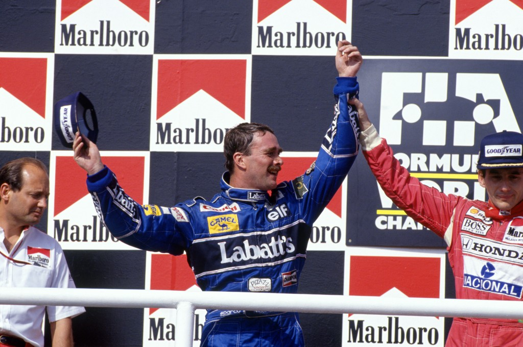 Hungaroring, Hungary, 14th - 16th August 1992, RD11. 2nd placed Nigel Mansell celebrates victory in the race with winner Ayrton Senna. Portrait. Podium. Photo: LAT Photographic/Williams F1. Ref: 1992williams05