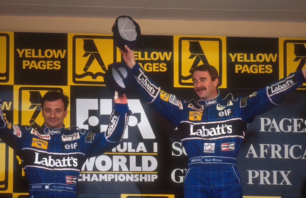 1992 South African Grand Prix. Kyalami, South Africa. 28/2-1/3 1992. Nigel Mansell, 1st position with teammate Riccardo Patrese, 2nd position (both Williams Renault) on the podium. Ref-92 SA 06. World Copyright - LAT Photographic